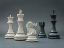 Chess pieces on gray