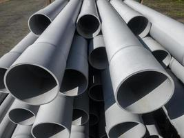 Large pipes piled up on a construction site