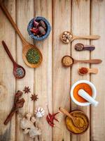Frame of spices and nuts on wood