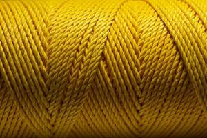 Close up macro shot of a yellow thread. photo