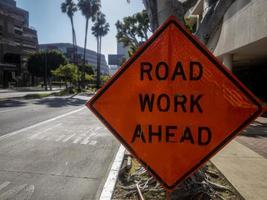 Road work ahead sign on an empty street