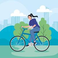 young woman riding a bike outdoors vector
