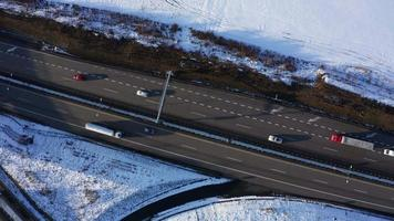 Aerial top down view of motorway and white field with radio tower in 4K video