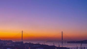 Timelapse of the Russian bridge at dawn. Vladivostok, Russia