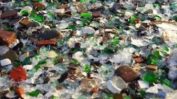 Multicolored Sea Glass on The Beach Background