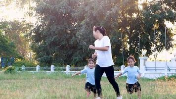 Two little girls and mother exercising together