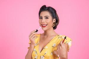 Fashion woman hand holding lip care photo