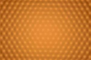 Blurred panel of orange LED lighting