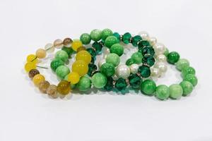 Colorful bracelets isolated on white background photo