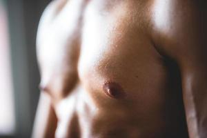 Close-up of man's upper body at gym