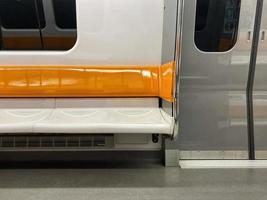 Orange and white subway seats photo