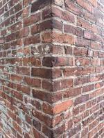 Corner of a red brick wall photo