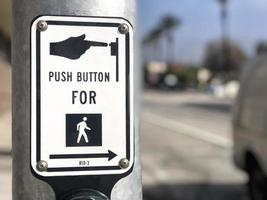 Push button for crossing sign with a blurry background