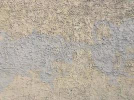 Yellow plaster wall with stains