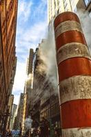 A steam pipe on the city street in New York City