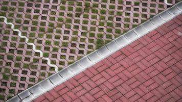 Brick paved road with grass photo