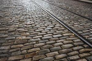 Cobblestone street with old train tracks in Brooklyn, NY