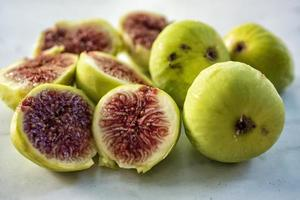 Green figs cut in half on a table