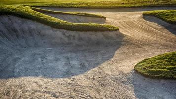Sand bunker at a golf course photo