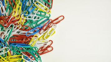 Colorful paperclips on a white table photo