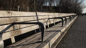 A long park bench in Brooklyn, NY photo
