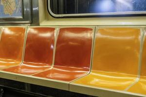 Colorful seats in a New York City subway car