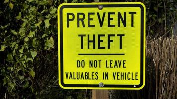 Yellow metal Prevent Theft sign