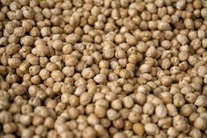 A pile of raw chickpeas for sale in the market photo