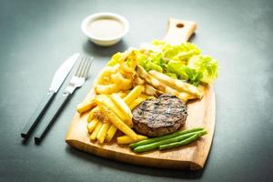 Grilled beef steak with french fries sauce and fresh vegetables