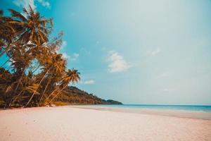 Tropical beach on a paradise island photo