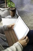 Woman working with tablet, blank screen