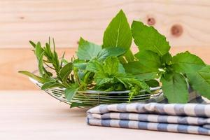 Fresh herbs with a cloth on a table photo
