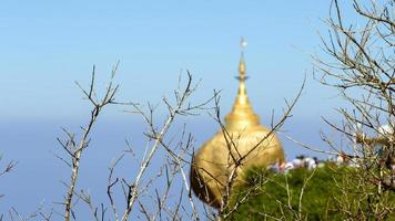 Ka Dai Dutt, Myanmar, 2020 - Bare tree branches in front of the pagoda photo