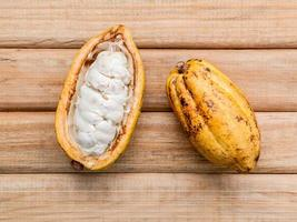 Cocoa fruit on wood