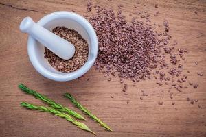 Flax seeds in white mortar photo