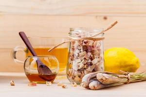 Cup of herbal tea with dried lemongrass photo