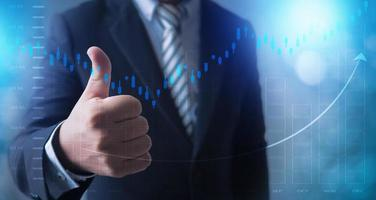 Business man holding thumbs up photo