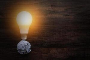 Light bulb on crumpled paper photo