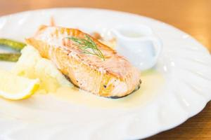 Grilled salmon steak on white plate