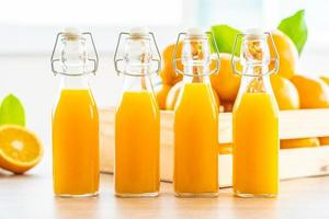 Fresh orange juice and oranges photo