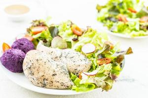 Grilled chicken breast and salad photo