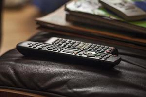Remote controls on a chair photo