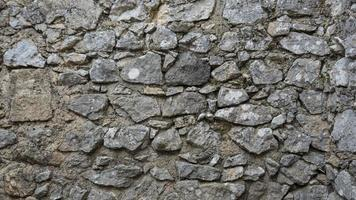 Old Castle wall made of small limestone bricks photo