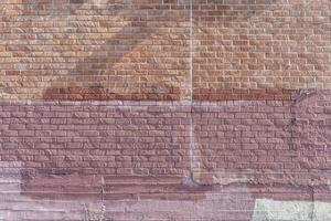Multi-colored wall with uneven bricks