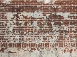 Red brick wall with white plaster