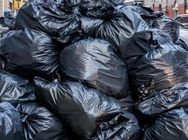 Black garbage bags piled up