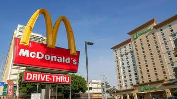 McDonald's sign with hotels in background in Los Angeles, California