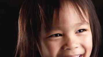 Close-up face portrait of cute little child looking at the camera video