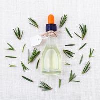 Rosemary oil on white photo