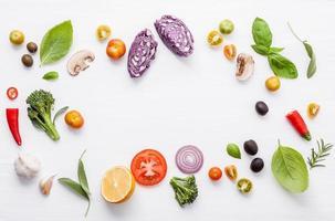 Frame of fresh ingredients on white photo